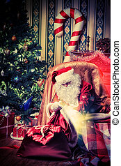 yuletide - Santa Claus having a rest in a comfortable chair...