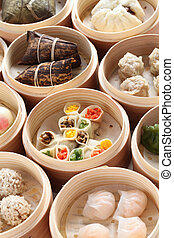 yumcha, dim sum in bamboo steamer - chinese cuisine