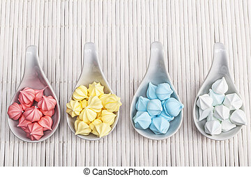 Yummy sweet stuff in colours on white wood