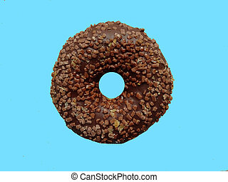 Yummy chocolate donut on colorful blue background. Top view