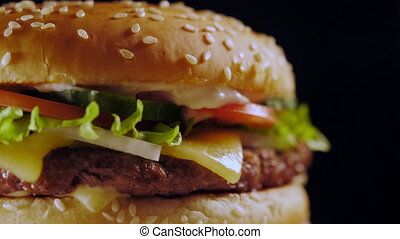 Yummy fast food concept. Fresh homemade grilled burger with...