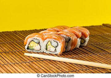 Yummy Fresh Sushi rolls - Fresh Sushi rolls on bamboo mat