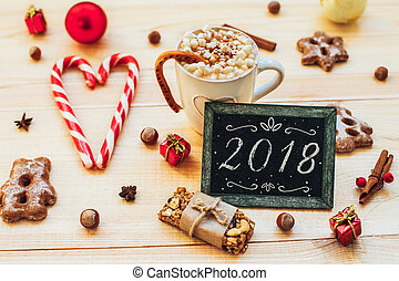 yummy New Year background. Christmas cookies and blackboard...