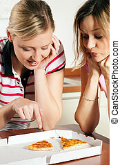 Yummy pizza! - Friends in eager anticipation of the last...