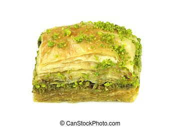 Yummy Turkish baklava with green pistachio nuts on white...