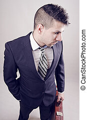 Yuong businessman - Young businessman with modern hairstyle...