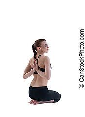 Yuong girl doing yoga posing with back to viewer - Yuong...