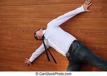 Yuong man in despair lying on the floor