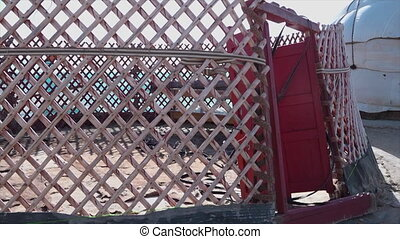 Yurt framework with a red door - A close-up shot of the...
