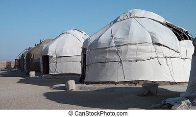 Yurts in a row in a town in Uzbekistan - A wide, still shot...