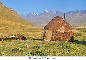 Yurts in Kyrgyzstan - Traditional yurt on green grasslands ...