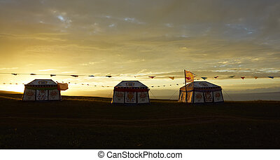 yurts in sunset