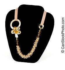 złoty, biżuteria, na, czarne tło
