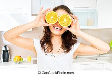 zabawny, oczy, kobieta, na, pomarańcza, kuchnia