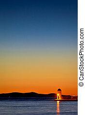 Zadar harbor lighthouse colorful twilight view, Croatia,...