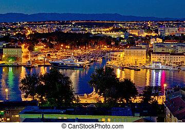 Zadar luxury yacht marina night view, with cityscape,...