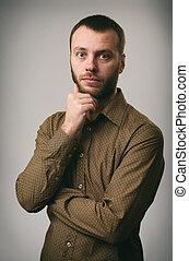 zadumany, młode przeglądnięcie, człowiek aparatu fotograficzny, broda