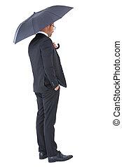 zakenman, beschutten, onder, zwarte paraplu