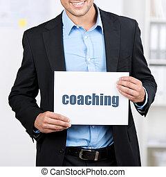zakenman, coachend, plakkaat, vasthouden, meldingsbord