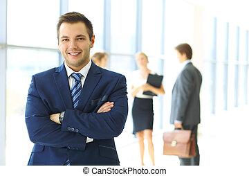 zakenman, collega's, achtergrond, kantoor, het glimlachen