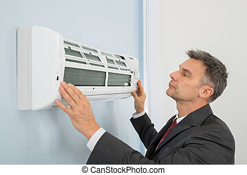 zakenman, controleren, klimaatregelaar, in, kantoor