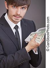 zakenman, dollars, enveloppe, vasthouden