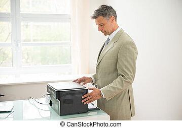 zakenman, gebruik, photocopy machine