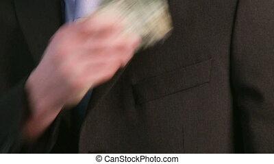 zakenman, het putten, geld, in, zak