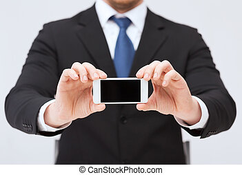 zakenman, het tonen, smartphone, scherm, leeg