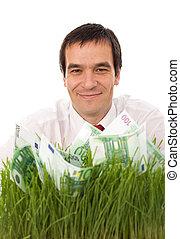 zakenman, met, groene, bankpapier, in, de, gras, -, vrijstaand, milieu, vriendelijk, handel concept