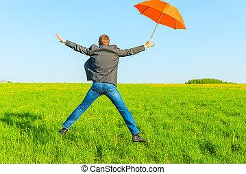 zakenman, met, paraplu, het springen in, een, akker