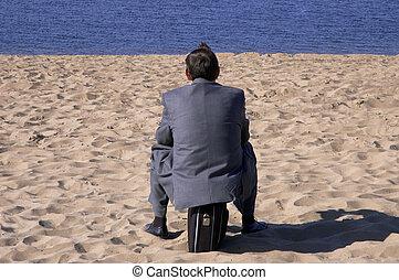 zakenman, op het strand