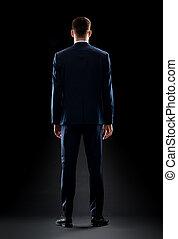 zakenman, op, zwart kostuum