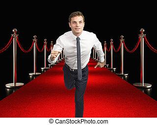 zakenman, rood tapijt