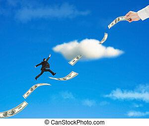 zakenman, springt, op, geld, trend, door, wolk, met, hand,...