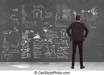 zakenmens , kijken naar, enig, diagrammen