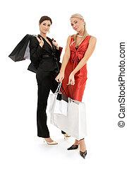 zakken, vrolijke , shoppen , twee meisjes
