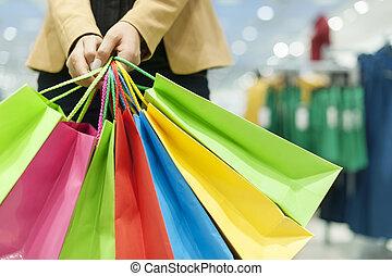 zakken, vrouw winkelen, vasthouden