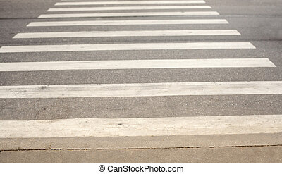Zebra cross walk on asphalt road