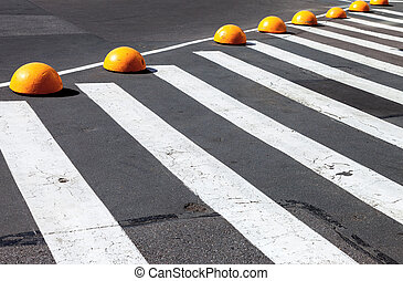 Zebra crossing with white lines on the asphalt