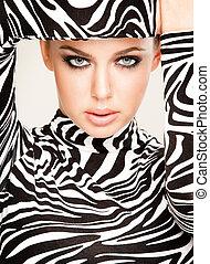 zebra fashion - gorgeous young woman posing in zebra pattern...