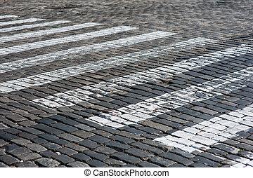 Zebra - pedestrian road crossing area in city