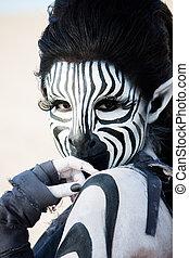 Zebra woman - striking black and white zebra woman looks...