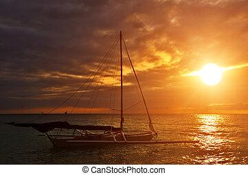 zeil, ondergaande zon , scheepje
