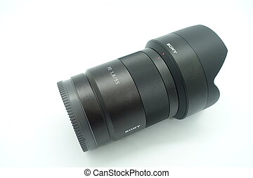 A zeiss 55mm f/1.8 lens against isolated white background. This lens is hugely popular due to its compact size and incredibly sharp optics