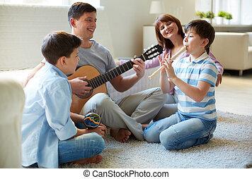 zenés, család