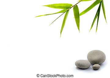 zen background - bamboo leavs and three stones isolated on ...