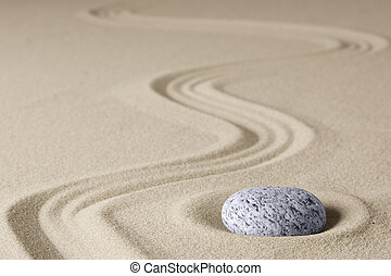 Zen background with stone and line in the sand