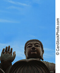 zen buddha against blue sky