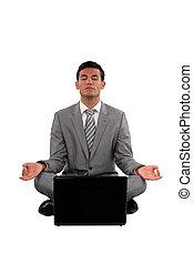 Zen businessman with a laptop